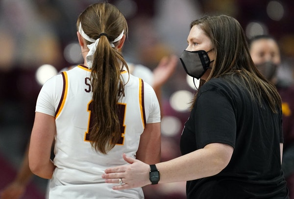 Gophers coach Lindsay Whalen gave a pat on the back to guard Sara Scalia after a loss to the Indiana Hoosiers last month.