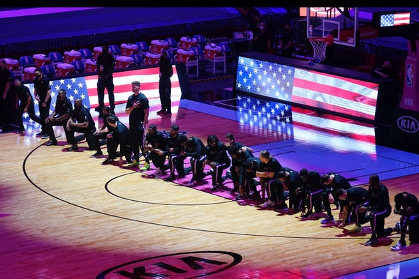 The Boston Celtics kneel during the playing of the National Anthem before the first half against the Miami Heat on Wednesday