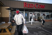 Bryan, a driver for Bite Squad who asked that his last name not be used, headed for his car after picking up a food order from Red Cow manager Jared L