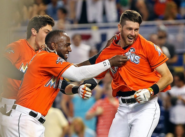 Miami's JT Riddle (39) celebrated his walk-off home run with teammates Marcell Ozuna (13) and Christian Yelich (21) on April 16, 2017.