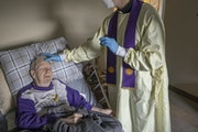 Rev. Andrew Jaspers gave the sacrament commonly known as last rites as a precaution to COVID patient Chuck Schuh, 85, Saturday. Relatives gave permiss