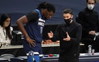 Timberwolves coach Ryan Saunders confers with center Naz Reid, who headed to the bench after getting into foul trouble during the first half against D