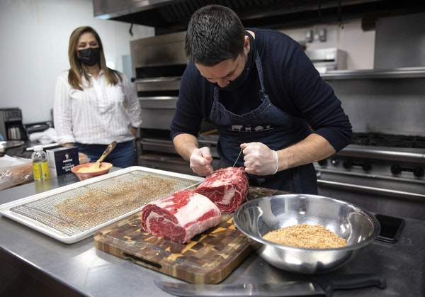 Maribel Moreno-Musillami, owner of Purely Meat Co., watched chef Matt Ronan tie up a Wagyu prime rib to offer on the company's direct-to-consumer we
