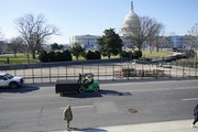 Fencing is placed around the exterior of the Capitol grounds, Thursday morning, Jan. 7, 2021 in Washington. The House and Senate certified the Democra