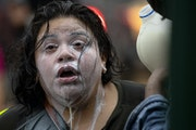 A protester was doused with milk after exposure to percussion grenades and tear gas at the Minneapolis 3rd Police Precinct.        ] CARLOS GONZALEZ �