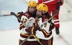 Gophers forward Grace Zumwinkle (12) was mobbed by Taylor Heise after she scored the Gophers third goal vs. Ohio State in November.
