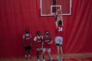 Chet Holmgren of Minnehaha Academy dunked during a drill at practice Tuesday at the school in Minneapolis. Masks are required during practice and game