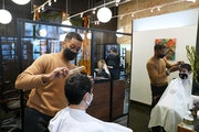 Brian Graham cut Faye Washington's hair in December at his former Tuesday afternoon at his former North Loop salon. (ANTHONY SOUFFLE • anthony.sou