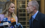 FILE - In this April 16, 2018, file photo, adult film actress Stormy Daniels, left, stands with her then lawyer, Michael Avenatti, during a press conf