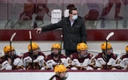 Gophers coach Brad Frost watched from the bench during a game earlier this season.