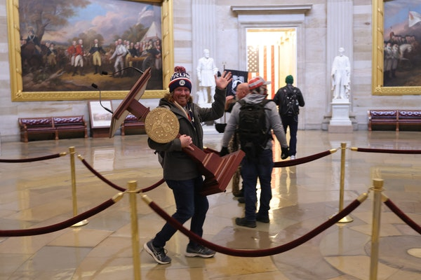 A viral photo showed a man carrying U.S. Speaker of the House Nancy Pelosi's lectern through the U.S. Capitol in Washington, D.C., on Jan. 6, 2021,