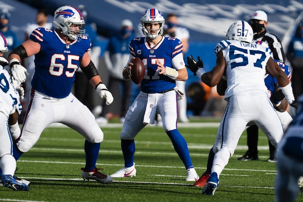 Quarterback Josh Allen drops back for a pass as the Buffalo Bills hosted the Indianapolis Colts for their first playoff game in 25 seasons, at Ralph W