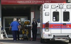 In this Jan. 5 photo, a LifeLine Ambulance arrives at the CHA Hollywood Presbyterian Medical Center  in Los Angeles.