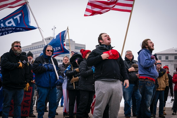 People sang the national anthem Saturday during a rally at the Minnesota State Capitol in support of President Donald Trump.