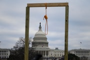 As throngs of people pushed toward the U.S. Capitol on Wednesday, a makeshift gallows was visible on the building's west side.