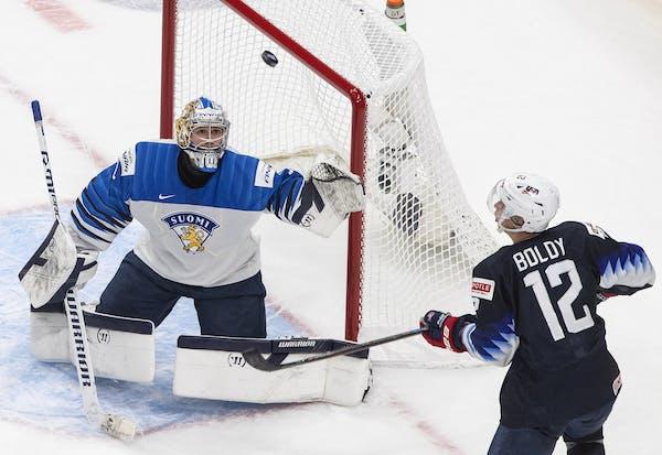 United States' Matthew Boldy (12) looks for a rebound from Finland goalie Kari Piiroinen (1) during second-period IIHF World Junior Hockey Champio