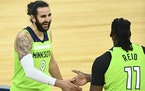 Minnesota Timberwolves guard Ricky Rubio (9) high fived center Naz Reid (11) after Reid's buzzer-beating 3-pointer to end the first quarter against
