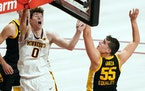 Minnesota center Liam Robbins (0) went up for a shot over Iowa center Luka Garza (55) in the second half. ] ANTHONY SOUFFLE • anthony.souffle@startr