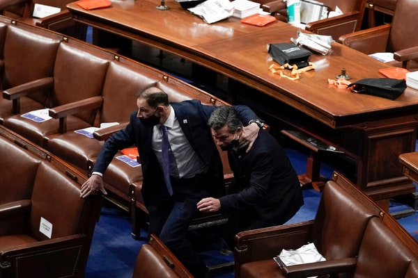 Lawmakersevacuatedthe floor as rioters try to break into the House Chamber at the U.S. Capitol on Wednesday, Jan. 6, 2021, in Washington.