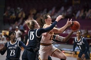 Gophers forward Kayla Mershon was fouled by Penn State forward Johnasia Cash (33) in the second quarter.