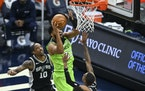 Timberwolves center Karl-Anthony Towns scored on a layup after an offensive rebound in the fourth quarter Saturday night against the Spurs.