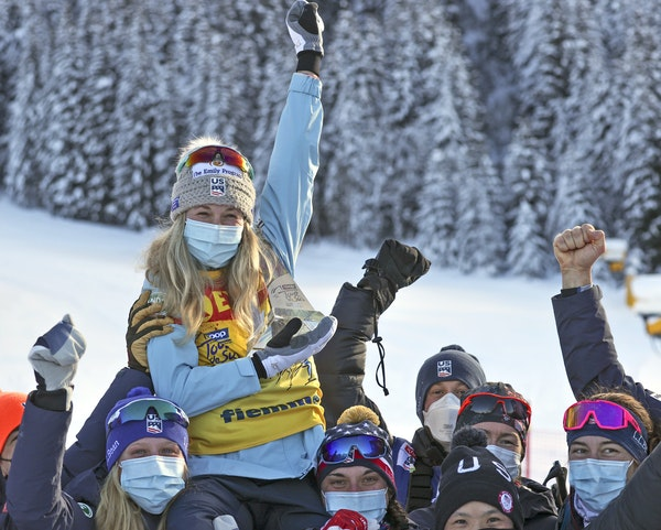 A victory ride on U.S. teammates' shoulders, top, elicited exultation for Afton's Jessie Diggins; however, tears flowed as she took a moment alone