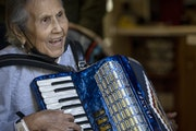 """Before contracting COVID, Juanita Moran played """"Happy Birthday"""" to herself with her accordion as she celebrated her 99th birthday as her family st"""