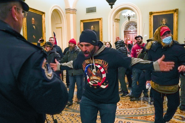 Trump supporters confronted U.S. Capitol Police on Wednesday in the hallway outside of the Senate chamber at the Capitol in Washington. Doug Jensen, a