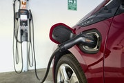 FILE - This Oct. 17, 2018 photo shows a Chevrolet Volt hybrid car charging at a ChargePoint charging station at a parking garage in Los Angeles. (AP P