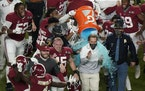 Alabama coach Nick Saban got his sports-drink bath after the Crimson Tide's 52-24 victory over Ohio State in the College Football Playoff national c