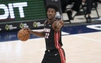 The Miami Heat were preparing to be without eight players — including All-Star Jimmy Butler — for several days because of possible exposure to the