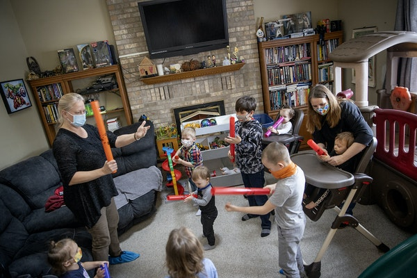 "In-home child provider Kim Mueller, right, participated in a music session in which she hired Cindi Gervais, cq, left, of ""Growing with Music,"" as"