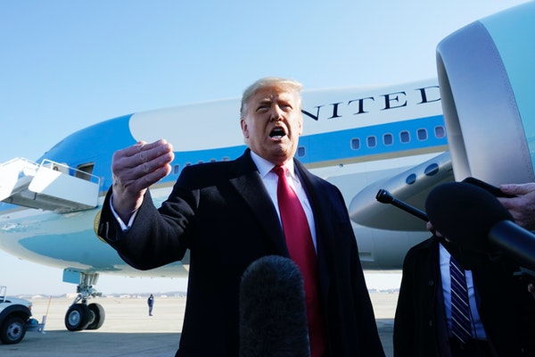 President Donald Trump speaks to the media before boarding Air Force One, at Andrews Air Force Base, Md. The President is traveling to Texas.