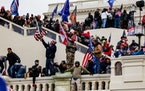SAMUEL CORUM, TNS - TNS Pro-Trump supporters storm the U.S. Capitol following a rally with President Donald Trump on Wednesday, Jan. 6, 2021 in Washin