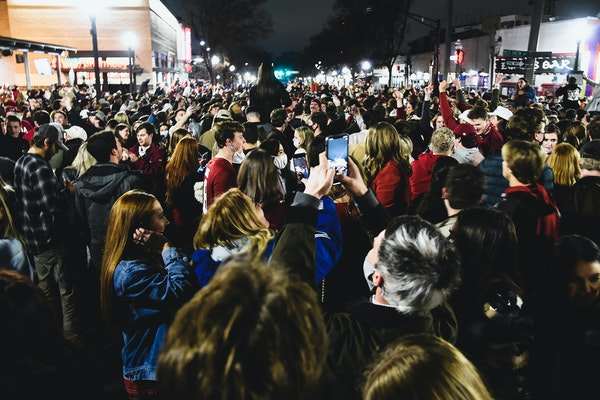 Alabama fans celebrate in the street in Tuscaloosa, Ala., Monday night, Jan. 11, 2021, after Alabama defeated Ohio State 52-24 in the NCAA college foo