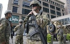 Members of the Minnesota National Guard stood at S. 7th Street and Nicollet Mall, Aug. 27, 2020, in Minneapolis, as community members and business own