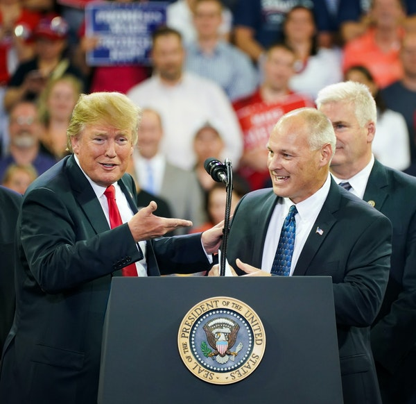 President Donald Trump and U.S. Rep. Pete Stauber at a 2018 campaign rally in Duluth, with Rep. Tom Emmer in the background.
