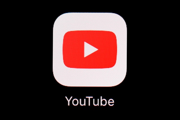 """The YouTube app on an iPad. YouTube said it would be suspending U.S. President Donald Trump's channel for at least a week amid concerns around """"on"""
