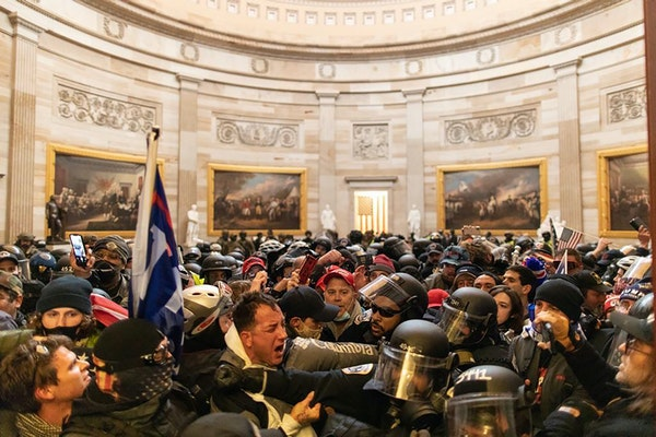 Police tried to hold back supporters of President Donald Trump who breached security and entered the U.S. Capitol building Jan. 6 in Washington D.C.