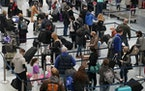 MSP's terminal 1 was filled with holiday travelers in December 2020.