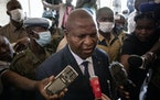 President Faustin-Archange Touadera speaks to the media after casting his vote at the Lycee Boganda polling station in the capital Bangui, Central Afr