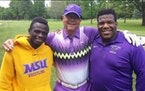 Fred Roufs (center) with Minnesota State Mankato wrestlers Paul Selman and Malcolm Allen at a fundraising golf tournament for the university a couple