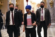 Rep. Ilhan Omar, D-Minn., walks to the House chamber on Capitol Hill in Washington, Wednesday, Jan. 13, 2021.