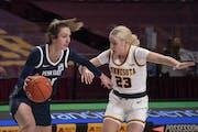 Minnesota Gophers guard Katie Borowicz (23) fouled Penn State Lady Lions guard Kelly Jekot (25) in the fourth quarter.   ]  JEFF WHEELER • jeff.whee