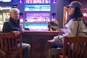 Pam Carlson, left, and Amy McClure calmly discussed and debated the second impeachment of President Trump inside McKenzie's Bar & Grill in Hermantow