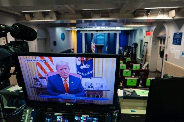 A video of President Donald Trump is displayed on a monitor in the briefing room of the White House after the House of Representatives voted 232 to 19