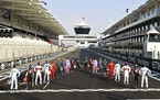 F1 drivers pose for a photo ahead of a race in the Yas Marina racetrack in Abu Dhabi, United Arab Emirates, Sunday, Dec. 13, 2020. (Brynn Lennon, Pool