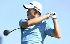 Collin Morikawa hits from the first tee during the final round of the Tournament of Champions at Kapalua Plantation Course in Kapalua, Hawaii. (Matthe