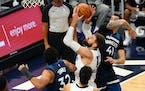Memphis center Jonas Valanciunas, center, shoots over Timberwolves center Karl-Anthony Towns (32) and forward Juancho Hernangomez (41) in the second h