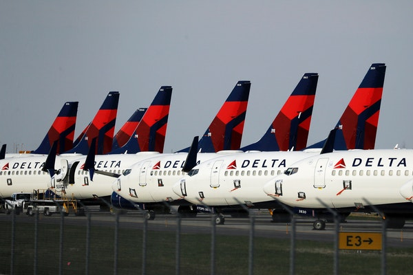 FILE - In this April 1, 2020, file photo, several dozen Delta Air Lines jets are parked at Kansas City International Airport in Kansas City, Mo. Delta